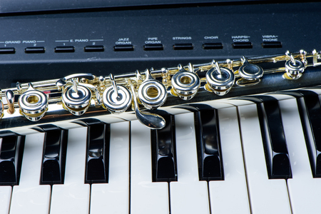 Flute instrument on the piano keyboard Stock Photo