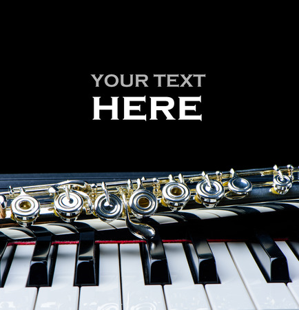 Piano keyboard and flute instrument close up with place for your text Stock Photo
