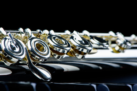 flute key: Jazz music instrument flute close up isolated on black background
