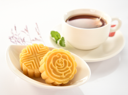 a pastry with mostly sweet fillings made for the Moon Festival, hence loosely translated as a moon cake or mung bean pastry. Stock Photo