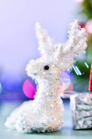 white reindeer doll for Christmas decoration on bokeh light