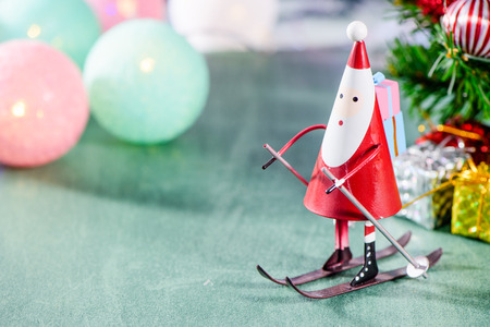 christmas decoration, skating santa claus, christmas Ambience image isolated on green background