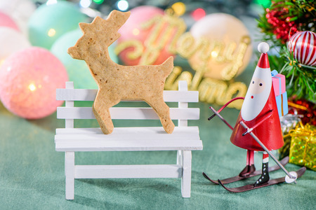 christmas decoration, skating santa claus with gingerbread Man and Christmas imagery isolated on green background