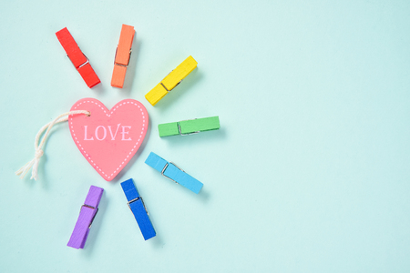 Love eqality rainbow with shining love, blue green background, blank for text, top view Stock Photo