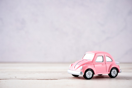 Taiwan, Tainan - April 17, 2018: Little beetle pink car in blank background for text, Valentine's Day concept, Mother's Day concept, macro shot. Sajtókép