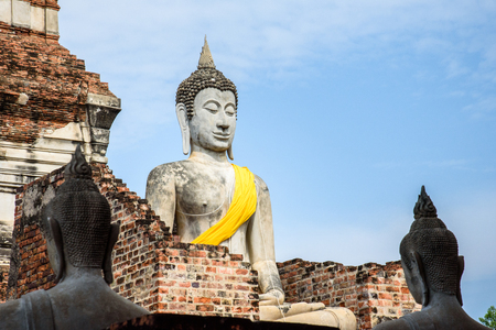 Buddha statues in Phra Nakhon Si Ayutthaya, at yai chaimongkol Thailand, one of the famous historical landmark in the center of Thailand. Stock Photo