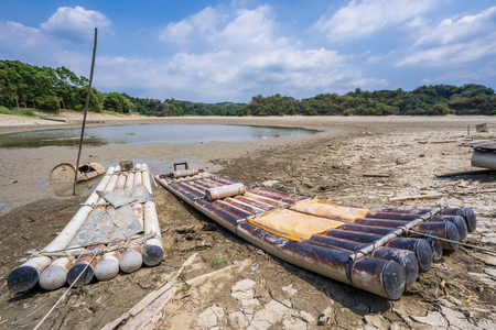 Lake of Dreams, a small but beautiful fishing port located in Wushantou Reservoir, Guantian, Tainan, Taiwan is drying up with cracks and bamboo boats are left aside. Stock Photo