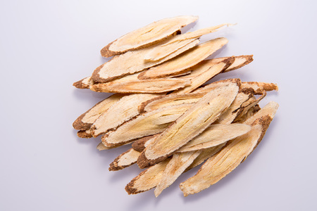 Chinese herbal medicines -- Astragalus on white background, blank for text copy space,