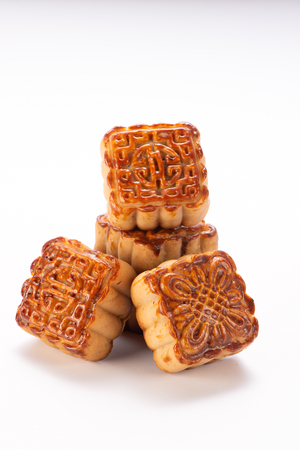 Mooncake in chinese traditional mid-autumn festival(moon festival) isolated on white background with clipping path(saved path), and copy space(text space), close up. Archivio Fotografico