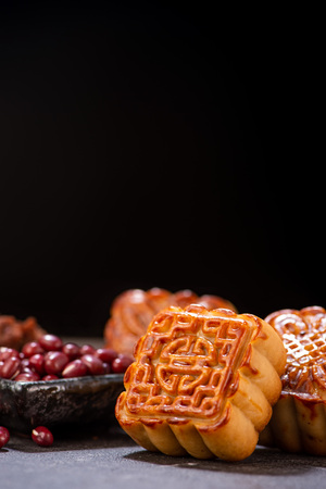 Mooncake in chinese traditional mid-autumn festival(moon festival) with copy space(text space) and table setting, close up.