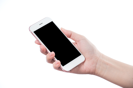 Concept of woman's hand holding a smartphone isolated on white background, clipping path, blank for webpage or message. Stock fotó