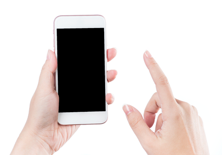 Concept of woman's hand holding a smartphone and pointing with figer isolated on white background, clipping path, blank for webpage or message.