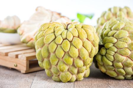 fresh sugar apple fruit(Custard Apple),sweetsop on wooden table background