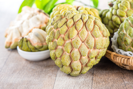 fresh sugar apple fruit(Custard Apple),sweetsop on wooden table background 스톡 콘텐츠 - 106927162