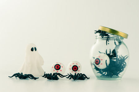 Beautiful halloween decoration trick or treat on white background with filter, concept of halloween party, copy space(text space), close-up, blank for text