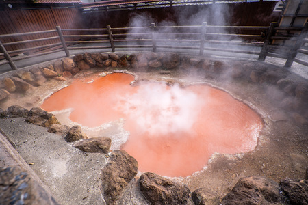 Kamado Jigoku (Cooker Hell) pond in autumn, which is one of the famous natural hot springs viewpoint, representing the various hells in Beppu