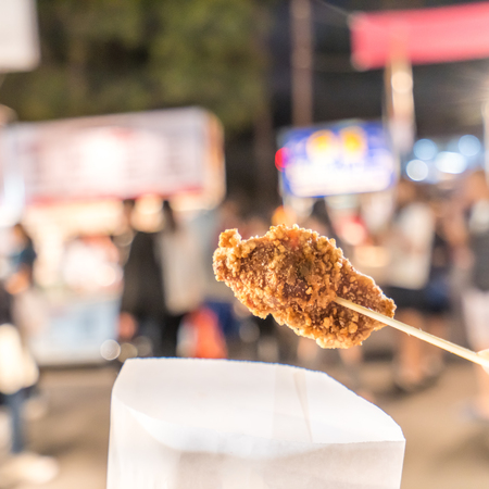 Fresh and delicious Taiwanese deep fried chicken (Salt crispy chicken) in Taiwan's night market, close up.
