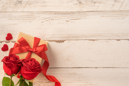 gift box with red ribbon bow, concept of giving present and Valentines, anniversary, mothers day and birthday surprise, flat lay, top view Stock Photo
