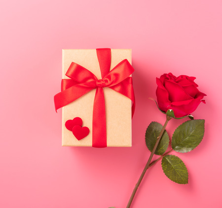 Giving present and celebration concept at Valentines day, anniversary, mothers day and birthday surprise on pink background, copyspace, topview