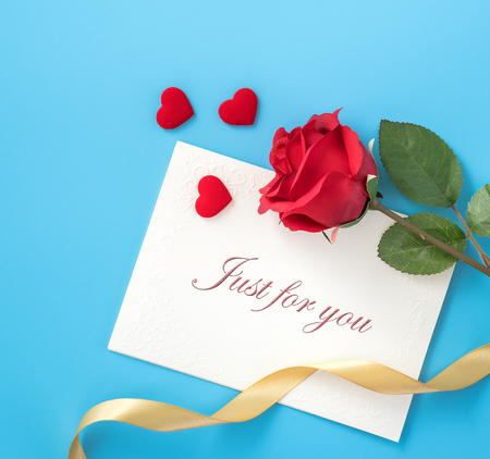Concept of beautiful Valentine's day, anniversary, mother's day and birthday present and greetings on blue background, copyspace, topview, mockup
