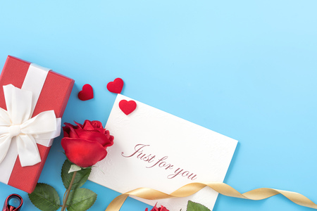 Beautiful greeting invitation card, concept of mother day, Valentine day, anniversary and birthday isolated on blue color background, copy space, top view, mock up, flat lay