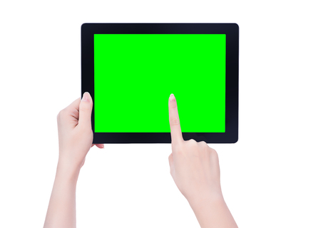 Young beautiful girl holding a black tablet pc template with green screen isolated on white background