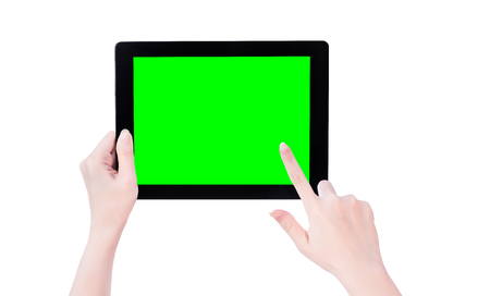 Young beautiful girl holding a black tablet pc template with green screen isolated on white background, close up