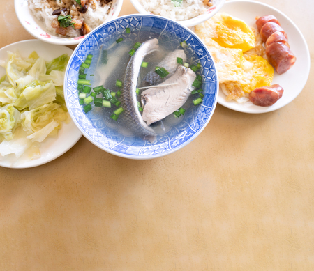 Milkfish skin soup, distinctive Taiwan delicacy food in Tainan. Famous meal set for lunch or breakfast with vegetable, top view, copy space, close up Stock Photo