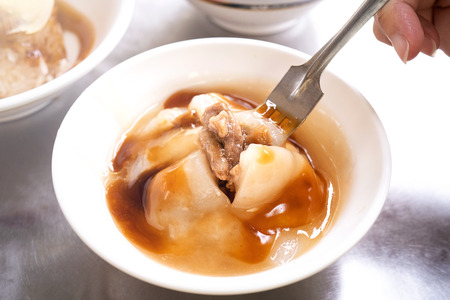 Bawan (Ba wan), taiwanese meatball delicacy, delicious street food, fried starch wrapped round shaped dumpling with pork inside, close up, copy space Stock Photo