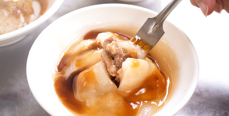 Bawan (Ba wan), taiwanese meatball delicacy, delicious street food, fried starch wrapped round shaped dumpling with pork inside, close up, copy space 写真素材