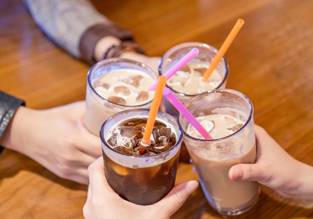 Party concept, girl with friends hold coffee cups and say cheers happy hangout together in cafe, lifestyle, copy space, top view, close up Foto de archivo