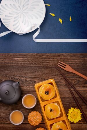 Creative Moon cake Mooncake design inspiration, enjoy the moon in Mid-Autumn festival with pastry and tea on wooden table concept, top view, flat lay Stock Photo