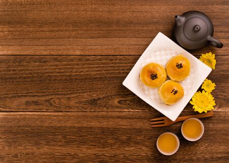 Mid-Autumn Festival mooncakes and tea set on wooden table with copy space, top view, flat lay 写真素材 - 129440412
