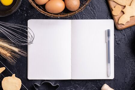 Making cookies cookbook recipe design concept, baking ingredients preparation layout with notebook, top view, flat lay, overhead, mockup copy space. Stock Photo