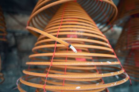 Burned coil swirl incense in Macau (Macao) temple, traditional Chinese cultural customs to worship god, close up, lifestyle.