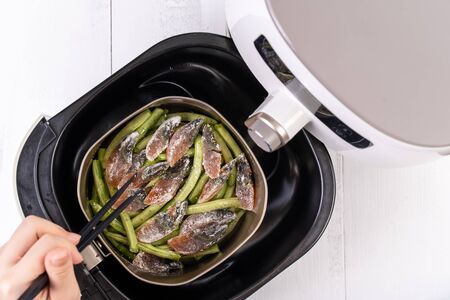 Air fryer meal, cooking green bean, pidan dishes cookery with Airfryer at home, delicious cuisine in Taiwan, Asia, Asian Taiwanese food, close up, top view.