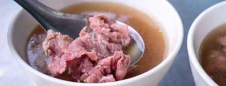 Beef soup - famous food in Taiwan, Asia, Asian Taiwanese street delicacy cuisine, close up, lifestyles, traditional breakfast in Tainan.