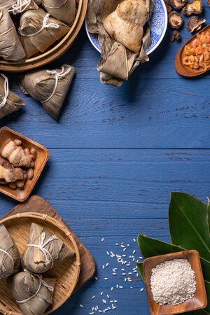 zongzi - Dragon Boat Festival concept Rice dumpling, traditional Chinese food on blue wooden background for Duanwu Festival, top view, flat lay design concept.