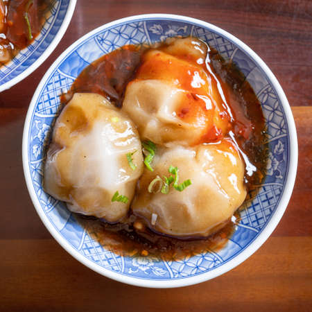 Bawan (Ba wan), Taiwanese meatball delicacy, delicious street food, steamed starch wrapped round shaped dumpling with pork inside, close up, copy space