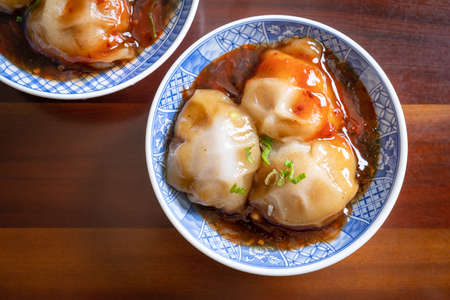 Bawan (Ba wan), Taiwanese meatball delicacy, delicious street food, steamed starch wrapped round shaped dumpling with pork inside, close up, copy space Reklamní fotografie