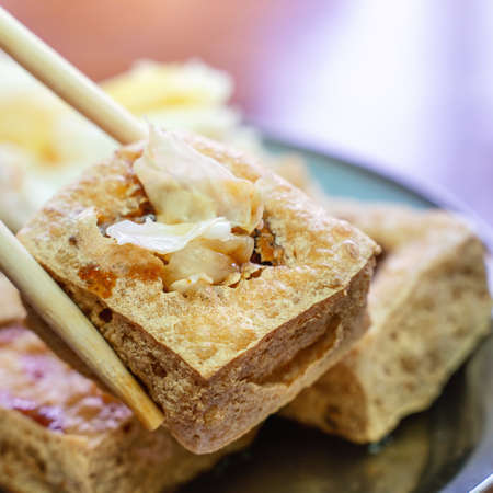 Deep fried stinky tofu, fermented bean curd with pickled cabbage vegetable, famous and delicious street food in Taiwan, lifestyle.