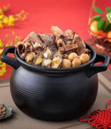 Traditional food of Chinese lunar new year, Buddha jumps over the wall, Chinese Soup Casserole dish, Buddha's Temptation, named Fo Tiao Qiang, close up.