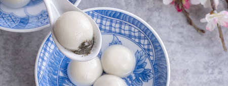 Top view of big tangyuan yuanxiao (glutinous rice dumpling balls) for lunar new year festival food, words on the golden coin means the Dynasty name it made. Stok Fotoğraf