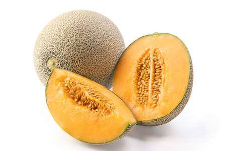 Close up of beautiful tasty sliced juicy cantaloupe melon, muskmelon, rock melon isolated on white background. Standard-Bild