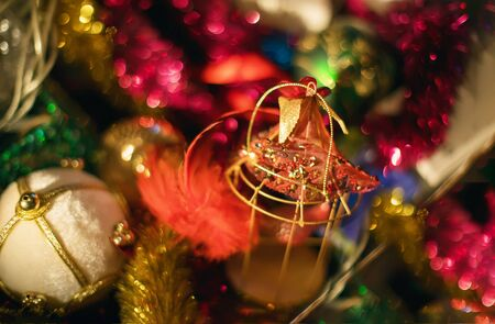 Sparkling christmas tree decorations with spangles and tinsel and colourful bokeh