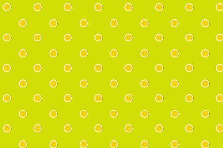 Seamless pattern of fresh lemon round cut on green