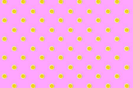 Seamless pattern of fresh lemon round cut on pink Stok Fotoğraf
