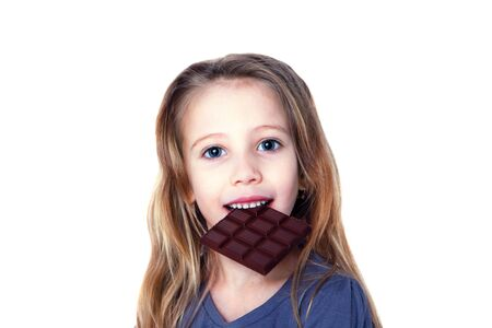 Smiling girl eating chocolate isolated on white Stok Fotoğraf
