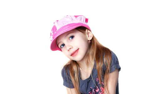 Cute girl wearing pink cap isolated on white