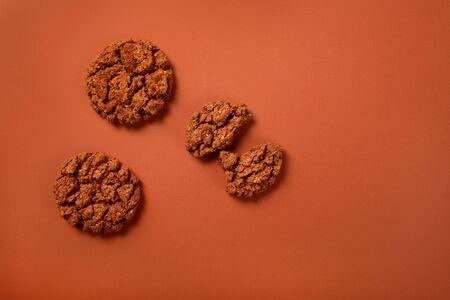 Chocolate brown cookies on brown backgroubd
